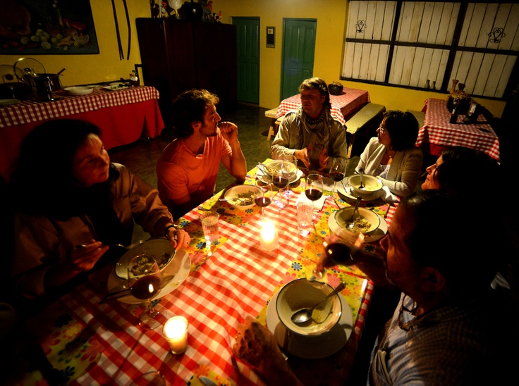 An intimate dinner with the lodge owners at Villa Pajon in Valle Nuevo National Park, Dominican Republic. Free and independent travels look for these kinds of opportunities to eat authentic dishes and interact with local people.