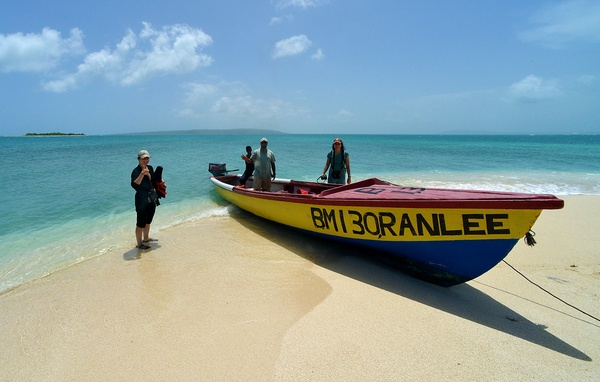 CBT Project Team landing their boat on one of the pristine beaches at Portland Bight Protected Area, 2012.
