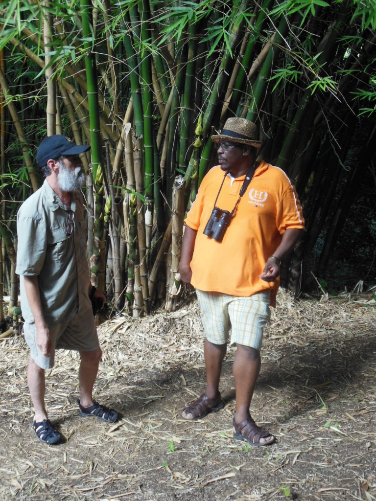 Guide Terrance Louison (right) chatting with a trip participant