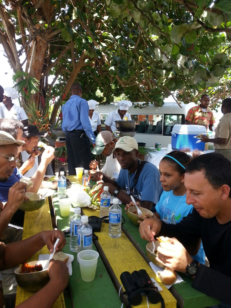 Participants enjoying oildown, the national dish of Grenada, at Bathway Beach in northern Grenada