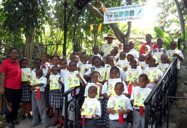 Students receive educational coloring books, made available by the Society for the Conservation and Study of Caribbean Birds.